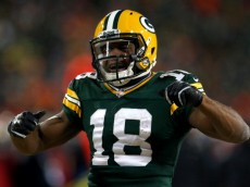 GREEN BAY, WI - JANUARY 05:  Randall Cobb #18 of the Green Bay Packers celebrates after a first down catch in the fourth quarter against the San Francisco 49ers during their NFC Wild Card Playoff game at Lambeau Field on January 5, 2014 in Green Bay, Wisconsin.  (Photo by Jonathan Daniel/Getty Images)