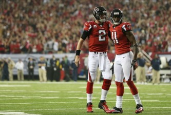 ATLANTA, GA - JANUARY 13:  Matt Ryan #2 and  Julio Jones #11 of the Atlanta Falcons celebrate during their NFC Divisional Playoff Game against the Seattle Seahawks at Georgia Dome on January 13, 2013 in Atlanta, Georgia.  (Photo by Streeter Lecka/Getty Images)