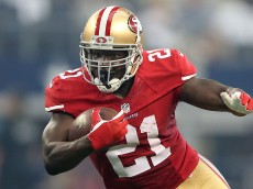 ARLINGTON, TX - SEPTEMBER 07: Frank Gore #21 of the San Francisco 49ers carries the ball against the Dallas Cowboys in the first half at AT&T Stadium on September 7, 2014 in Arlington, Texas. (Photo by Christian Petersen/Getty Images)