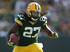 GREEN BAY, WI - SEPTEMBER 14:  Running back Eddie Lacy #27 of the Green Bay Packers rushes the football against the New York Jets during the NFL game at Lambeau Field on September 14, 2014 in Green Bay, Wisconsin.  The Packers defeated the Jets 31-24.  (Photo by Christian Petersen/Getty Images)