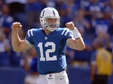 INDIANAPOLIS, IN - SEPTEMBER 28:  Andrew Luck #12 of the Indianapolis Colts celebrates after a touchdown during the game against the Tennessee Titans at Lucas Oil Stadium on September 28, 2014 in Indianapolis, Indiana.  (Photo by Andy Lyons/Getty Images)