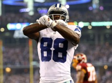 ARLINGTON, TX - OCTOBER 27:  Dez Bryant #88 of the Dallas Cowboys celebrates his touchdown against the Washington Redskins during the first half at AT&T Stadium on October 27, 2014 in Arlington, Texas.  (Photo by Ronald Martinez/Getty Images)