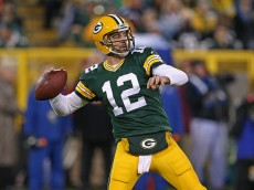 GREEN BAY, WI - NOVEMBER 09: Quarterback  Aaron Rodgers #12 of the Green Bay Packers throws a 56 yard touchdown in the second quarter against the Chicago Bears at Lambeau Field on November 9, 2014 in Green Bay, Wisconsin. (Photo by Jonathan Daniel/Getty Images)
