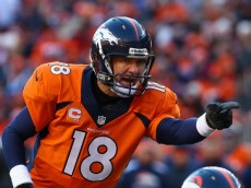 DENVER, CO - JANUARY 12:   Peyton Manning #18 of the Denver Broncos calls a play during the AFC Divisional Playoff Game against the San Diego Chargers at Sports Authority Field at Mile High on January 12, 2014 in Denver, Colorado.  (Photo by Doug Pensinger/Getty Images)