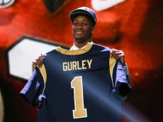 CHICAGO, IL - APRIL 30:  Todd Gurley of the Georgia Bulldogs holds up a jersey after being picked #10 overall by the St. Louis Rams during the first round of the 2015 NFL Draft at the Auditorium Theatre of Roosevelt University on April 30, 2015 in Chicago, Illinois.  (Photo by Jonathan Daniel/Getty Images)