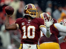 LANDOVER, MD - DECEMBER 08:  Quarterback Robert Griffin III #10 of the Washington Redskins throws a pass in the first half during an NFL game against the Kansas City Chiefs at FedExField on December 8, 2013 in Landover, Maryland.  (Photo by Patrick McDermott/Getty Images)
