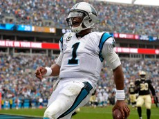 CHARLOTTE, NC - SEPTEMBER 27:  Cam Newton #1 of the Carolina Panthers rushes for a fourth quarter touchdown against the New Orleans Saints during their game at Bank of America Stadium on September 27, 2015 in Charlotte, North Carolina.  (Photo by Grant Halverson/Getty Images)