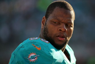 JACKSONVILLE, FL - SEPTEMBER 20:  Ndamukong Suh #93 of the Miami Dolphins looks on during a game against the Jacksonville Jaguars at EverBank Field on September 20, 2015 in Jacksonville, Florida.  (Photo by Mike Ehrmann/Getty Images)