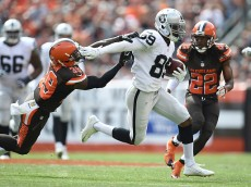 CLEVELAND, OH - SEPTEMBER 27:  Amari Cooper #89 of the Oakland Raiders stiff arms Tashaun Gipson #39 of the Cleveland Browns during the second quarter at FirstEnergy Stadium on September 27, 2015 in Cleveland, Ohio.  (Photo by Jason Miller/Getty Images)