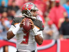 TAMPA, FL - OCTOBER 04:  Jameis Winston #3 of the Tampa Bay Buccaneers sets to throw during the second half of the game against the Carolina Panthers at Raymond James Stadium on October 4, 2015 in Tampa, Florida.  (Photo by Rob Foldy/Getty Images)