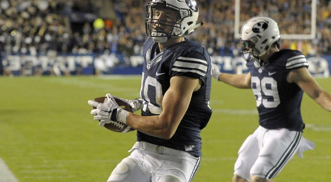 PROVO, UT - OCTOBER 2: Mitch Mathews #10 of the Brigham Young Cougars scores his 2nd fourth quarter touchdown as the Cougars beat the Connecticut Huskies 30-13 at LaVell Edwards Stadium on October 2, 2015 in Provo Utah. (Photo by Gene Sweeney Jr/Getty Images)