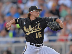OMAHA, NE - JUNE 25:  Pitcher Carson Fulmer #15 of the Vanderbilt Commodores delivers a pitch against the Virginia Cavaliers in the first inning during game three of the College World Series Championship Series on June 25, 2014 at TD Ameritrade Park in Omaha, Nebraska.  (Photo by Peter Aiken/Getty Images)