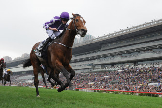 HONG KONG - DECEMBER 13:  Ryan Moore riding Highland Reel of United Kingdom winning Race 4, The Longines Hong Kong Vase during the Hong Kong International Races at Sha Tin racecourse on December 13, 2015 in Hong Kong, Hong Kong.  (Photo by Vince Caligiuri/Getty Images)