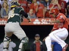 1408670977000-USP-MLB-Oakland-Athletics-at-Los-Angeles-Angels[1]