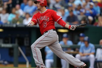 KANSAS CITY, MO - JUNE 28:  David Freese #6 of the Los Angeles Angels of Anaheim hits a two-run single in the sixth inning against the Kansas City Royals at Kauffman Stadium on June 28, 2014 in Kansas City, Missouri. (Photo by Ed Zurga/Getty Images)