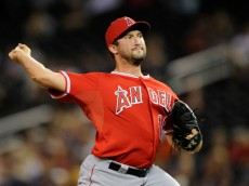 MINNEAPOLIS, MN - SEPTEMBER 4: Huston Street #16 of the Los Angeles Angels of Anaheim delivers a pitch against the Minnesota Twins during the ninth inning of the game on September 4, 2014 at Target Field in Minneapolis, Minnesota. The Angels defeated the Twins 5-4. (Photo by Hannah Foslien/Getty Images)