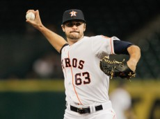 HOUSTON, TX - SEPTEMBER 16:  Nick Tropeano #63 of the Houston Astros throws in the first inning against the Cleveland Indians at Minute Maid Park on September 16, 2014 in Houston, Texas.  (Photo by Bob Levey/Getty Images)