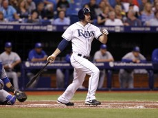 ST. PETERSBURG, FL - APRIL 3:  Matt Joyce #20 of the Tampa Bay Rays follows through as he hits a double during the second inning of a game against the Toronto Blue Jays on April 3, 2014 at Tropicana Field in St. Petersburg, Florida.  (Photo by Brian Blanco/Getty Images)