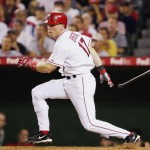 ANAHEIM, CA - AUGUST 18:  Darin Erstad #17 of the Los Angeles Angels of Anaheim hits a one run single in the 6th inning against the Boston Red Sox on August 18, 2005 at Angel Stadium in Anaheim, California.  (Photo by Lisa Blumenfeld/Getty Images)
