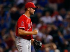 ARLINGTON, TX - AUGUST 15:  Huston Street #16 of the Los Angeles Angels celebrates after beating the Texas Rangers 5-4 at Globe Life Park in Arlington on August 15, 2014 in Arlington, Texas.  (Photo by Tom Pennington/Getty Images)