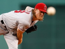 BOSTON, MA - AUGUST 19: Jered Weaver #36 of the Los Angeles Angels of Anaheim throws against the Boston Red Sox throws in the first inning at Fenway Park on August 19, 2014 in Boston, Massachusetts.  (Photo by Jim Rogash/Getty Images)