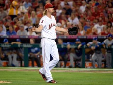 ANAHEIM, CA - OCTOBER 02: Jered Weaver #36 of the Los Angeles Angels reacts as he leaves the mound at the end of the fifth inning against the Kansas City Royals during Game One of the American League Division Series at Angel Stadium of Anaheim on October 2, 2014 in Anaheim, California.  (Photo by Harry How/Getty Images)
