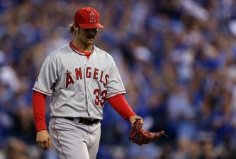 KANSAS CITY, MO - OCTOBER 05:  C.J. Wilson #33 of the Los Angeles Angels walks to the dugout in the first inning against the Kansas City Royals during Game Three of the American League Division Series at Kauffman Stadium on October 5, 2014 in Kansas City, Missouri.  (Photo by Ed Zurga/Getty Images)