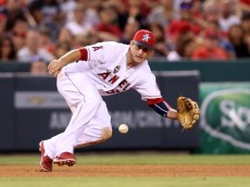 ANAHEIM, CA - JULY 04:   Third baseman David Freese #6 of the Los Angeles Angels of Anaheim dives to field a ground ball hit by L.J. Hoes of the Houston Astros for the first out of the seventh inning at Angel Stadium of Anaheim on July 4, 2014 in Anaheim, California.  (Photo by Stephen Dunn/Getty Images)