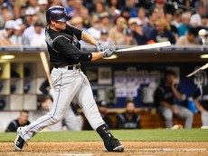 SAN DIEGO, CA - AUGUST 12:  Josh Rutledge #14 of the Colorado Rockies breaks his bat as he grounds out during the sixth inning of a baseball game against the San Diego Padres at Petco Park August, 12, 2014 in San Diego, California.  (Photo by Denis Poroy/Getty Images)
