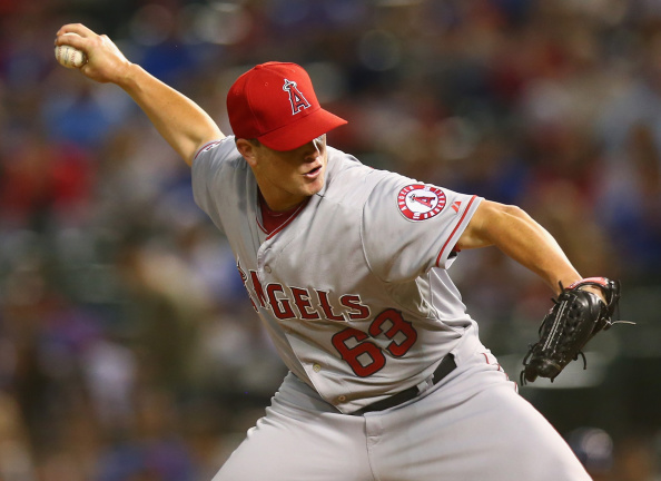 ARLINGTON, TX - SEPTEMBER 11:  Vinnie Pestano #63 of the Los Angeles Angels throws against the Texas Rangers in the fourth inning at Globe Life Park in Arlington on September 11, 2014 in Arlington, Texas.  (Photo by Ronald Martinez/Getty Images)