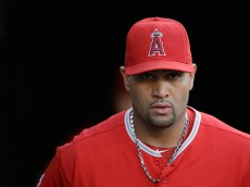 OAKLAND, CA - SEPTEMBER 22:  Albert Pujols #5 of the Los Angeles Angels of Anaheim walks to the dugout before their game against the Oakland Athletics at O.co Coliseum on September 22, 2014 in Oakland, California.  (Photo by Ezra Shaw/Getty Images)