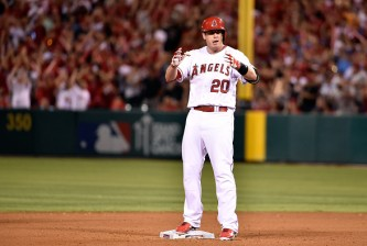 ANAHEIM, CA - OCTOBER 03:  C.J. Cron #20 of the Los Angeles Angels celebrates a double in the eighth inning against the Kansas City Royals during Game Two of the American League Division Series at Angel Stadium of Anaheim on October 3, 2014 in Anaheim, California.  (Photo by Denis Poroy/Getty Images)