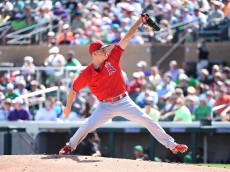 SCOTTSDALE, AZ - MARCH 17: Drew Rucinski #51 of the Los Angeles Angels of Anaheim delivers a first-inning pitch against the Colorado Rockies at Salt River Fields at Talking Stick on March 17, 2015 in Scottsdale, Arizona.  (Photo by Norm Hall/Getty Images)