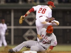 PHILADELPHIA, PA - MAY 13: Second baseman Chase Utley #26 of the Philadelphia Phillies attempts to turn a double play in the top of the eighth inning with catcher Chris Iannetta #17 of the Los Angeles Angels of Anaheim sliding into him on May 13, 2014 at Citizens Bank Park in Philadelphia, Pennsylvania. (Photo by Mitchell Leff/Getty Images)