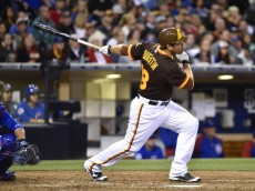 SAN DIEGO, CA - MAY 24:  Carlos Quentin #18 of the San Diego Padres hits a two-run home run during the eighth inning of a baseball game against the Chicago Cubs at Petco Park May 24, 2014 in San Diego, California.  (Photo by Denis Poroy/Getty Images)