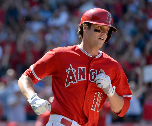 ANAHEIM, CA - JULY 20:  Grant Green #10 of the Los Angeles Angels reacts to his winning hit to score a run and win the game 6-5 over the Seattle Mariners during the ninth inning at Angel Stadium of Anaheim on July 20, 2014 in Anaheim, California.  (Photo by Harry How/Getty Images)