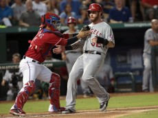 ARLINGTON, TX - AUGUST 16: Robinson Chirinos #61 of the Texas Rangers tags out in the fifth inning Josh Hamilton #32 of the Los Angeles Angels of Anaheim on a late run at Globe Life Park in Arlington on August 16, 2014 in Arlington, Texas.  (Photo by Rick Yeatts/Getty Images)