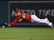 ANAHEIM, CA - SEPTEMBER 12:  Right fielder Kole Calhoun #56 of the Los Angeles Angels of Anaheim dives for a ball hit by Jose Altuve of the Houston Astros but isn't able to make the catch in the second inning at Angel Stadium of Anaheim on September 12, 2014 in Anaheim, California.  (Photo by Jeff Gross/Getty Images)