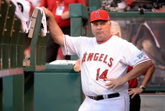 ANAHEIM, CA - OCTOBER 02:  Mike Scioscia #14 of the Los Angeles Angels looks on during prior to Game One of the American League Division Series against the Kansas City Royals at Angel Stadium of Anaheim on October 2, 2014 in Anaheim, California.  (Photo by Harry How/Getty Images)