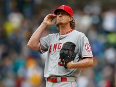 SEATTLE, WA - APRIL 06:  Starting pitcher Jered Weaver #36 of the Los Angeles Angels of Anaheim pauses on the mound after giving up an RBI double to Seth Smith of the Seattle Mariners in the fifth inning during the home opener at Safeco Field on April 6, 2015 in Seattle, Washington.  (Photo by Otto Greule Jr/Getty Images)