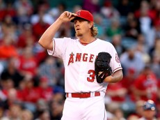 ANAHEIM, CA - APRIL 11:  Pitcher Jered weaver #36 of the Los Angeles Angels of Anaheim reacts during the five run fourth inning by the Kansas City Royals at Angel Stadium of Anaheim on April 11, 2015 in Anaheim, California.  (Photo by Stephen Dunn/Getty Images)