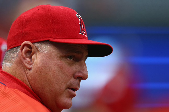 ARLINGTON, TX - APRIL 13:  Manager Mike Scioscia of the Los Angeles Angels of Anaheim during a game against the Texas Rangers at Globe Life Park in Arlington on April 13, 2015 in Arlington, Texas.  (Photo by Ronald Martinez/Getty Images)