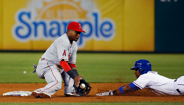 ARLINGTON, TX - APRIL 14:  Elvis Andrus #1 of the Texas Rangers beats the tag out at second base against Erick Aybar #2 of the Los Angeles Angels in the bottom of the second inning at Globe Life Park in Arlington on April 14, 2015 in Arlington, Texas.  (Photo by Tom Pennington/Getty Images)