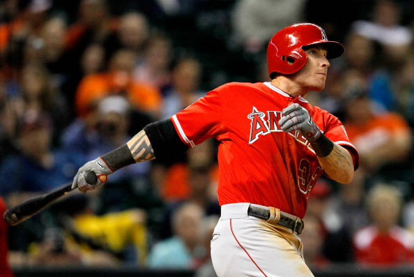 HOUSTON, TX - APRIL 04:  Josh Hamilton #32 of the Los Angeles Angels of Anaheim drives the ball to right field for a three run home run in the sixth inning against the Houston Astros at Minute Maid Park on April 4, 2014 in Houston, Texas.  (Photo by Bob Levey/Getty Images)
