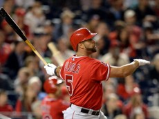 WASHINGTON, DC - APRIL 22: Albert Pujols #5 of the Los Angeles Angels of Anaheim hits a two-run home run against the Washington Nationals in the fifth inning at Nationals Park on April 22, 2014 in Washington, DC. The home run home was Albert Pujols' 500th. (Photo by Patrick Smith/Getty Images)