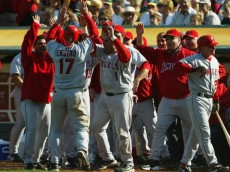 OAKLAND, CA - OCTOBER 2:  Darin Erstad #17 (C) of the Anaheim Angels celebrates with his teammates after scoring the go-ahead run in the eighth inning against the Oakland A's on October 2, 2004 at the Network Associates Coliseum in Oakland, California. The Angels defeated the A's 5-4 to clinch the AL West. (Photo by Jeff Gross/Getty Images)