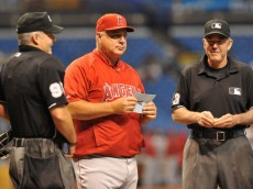 ST. PETERSBURG, FL - AUGUST 27: Manager Mike Scioscia of the Los Angeles Angels of Anaheim brings the lineup to home plate before play against the Tampa Bay Rays August 27, 2013 at Tropicana Field in St. Petersburg, Florida. (Photo by Al Messerschmidt/Getty Images)