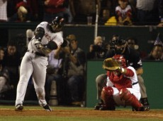 ANAHEIM, CA - OCTOBER 20:  Left fielder Barry Bonds #25 of the San Francisco Giants hits a home run during game two of the World Series against the Anaheim Angels at Edison Field on October 20, 2002 in Anaheim, California.  The Angels won 11-10, knotting the series at one game apiece.  (Photo by Jed Jacobsohn/Getty Images)
