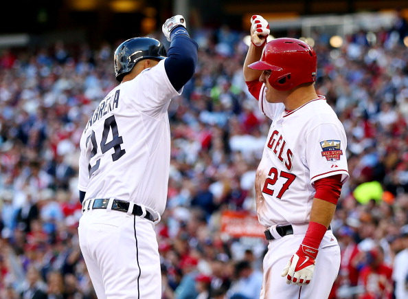 MINNEAPOLIS, MN - JULY 15:  American League All-Star Miguel Cabrera #24 of the Detroit Tigers celebrates with Mike Trout #27 of the Los Angeles Angels after hitting a home run in the first inning against the National League All-Stars during the 85th MLB All-Star Game at Target Field on July 15, 2014 in Minneapolis, Minnesota.  (Photo by Elsa/Getty Images)