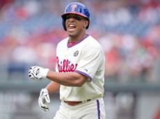 PHILADELPHIA, PA - AUGUST 11: Center fielder Ben Revere #2 of the Philadelphia Phillies winces after beating out an infield single in the bottom of the third inning against the New York Mets on August 11, 2014 at Citizens Bank Park in Philadelphia, Pennsylvania. (Photo by Mitchell Leff/Getty Images)